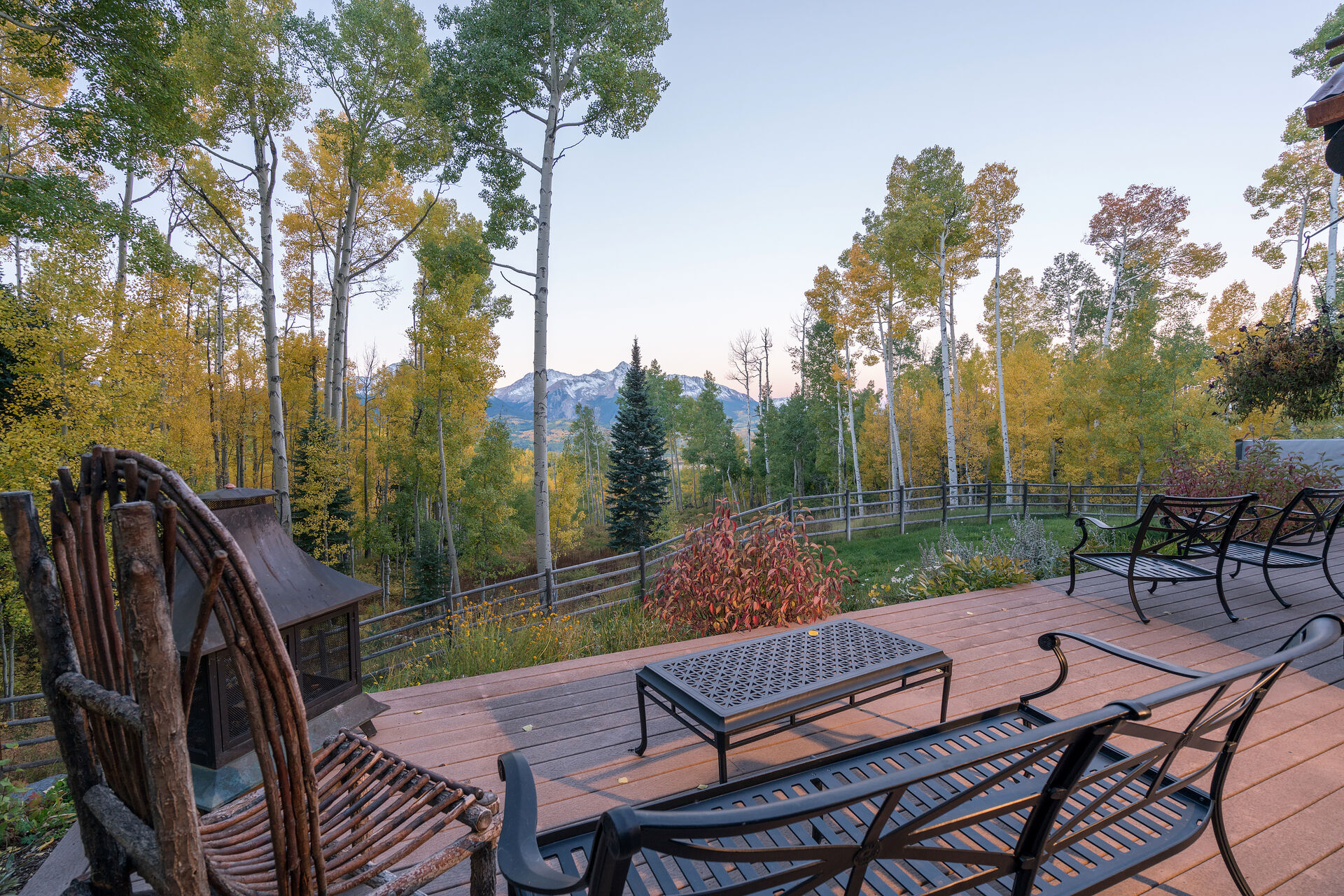 Views of the Mountains and Forest from the Spacious Deck with Ample Seating