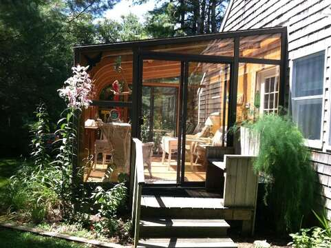Glass enclosed sunroom. The home also offers central air - 19 Old Cart Way Chatham Cape Cod New England Vacation Rentals