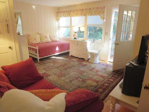 The TV room, offers access to the sunroom - 19 Old Cart Way Chatham Cape Cod New England Vacation Rentals