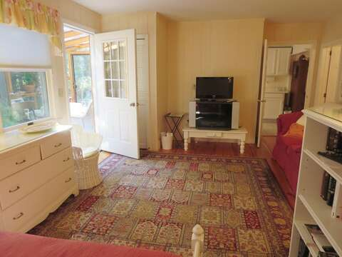 Looking toward the sunroom and kitchen from the TV room - 19 Old Cart Way Chatham Cape Cod New England Vacation Rentals