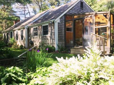 Gardens surround the home - Front of the home with sunporch- 19 Old CartWay - Chatham Cape Cod New England Vacation Rentals