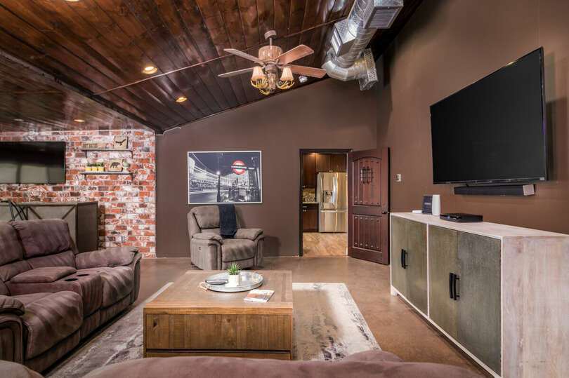 Game room with comfortable seating and TV