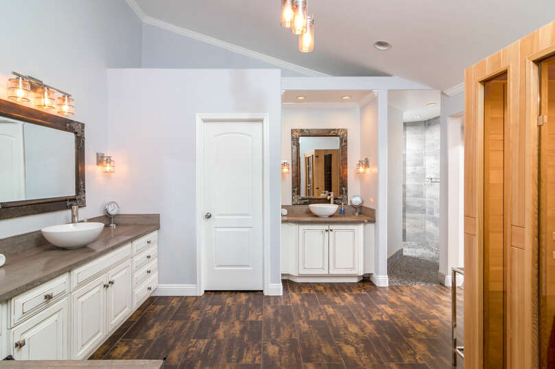 Master bathroom with dual vanities and personal sauna