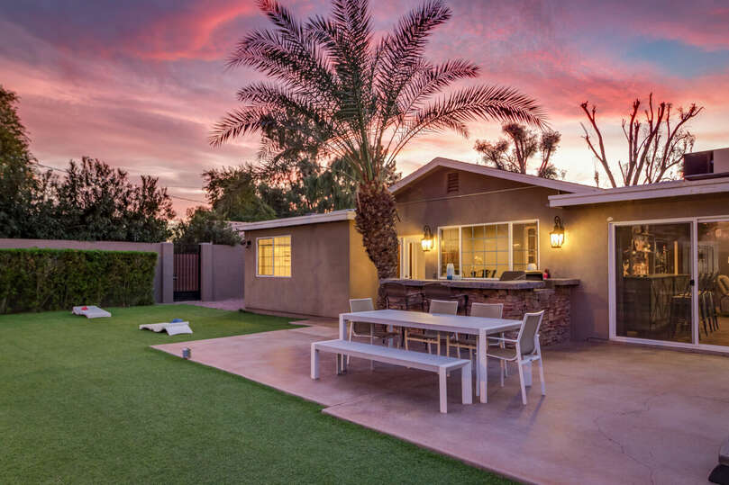 Enjoy the Arizona sunsets in this beautiful backyard, with a hot tub, volleyball court, gazebo, and plenty of lighting