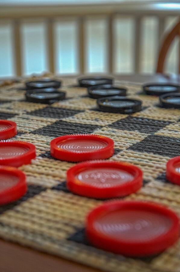 A close up of a checker board.