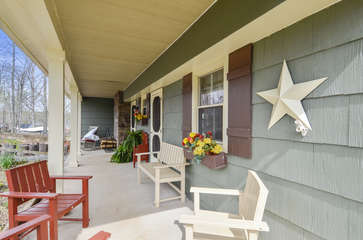 The front porch with wooden chairs.