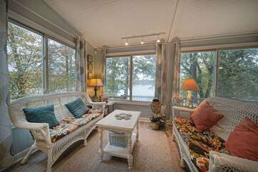 Large windows look out onto the lake from the great room.