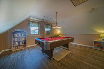 Wide photo of the upper loft pool table.