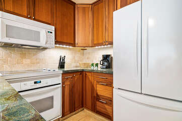 Kitchen with fridge and oven.