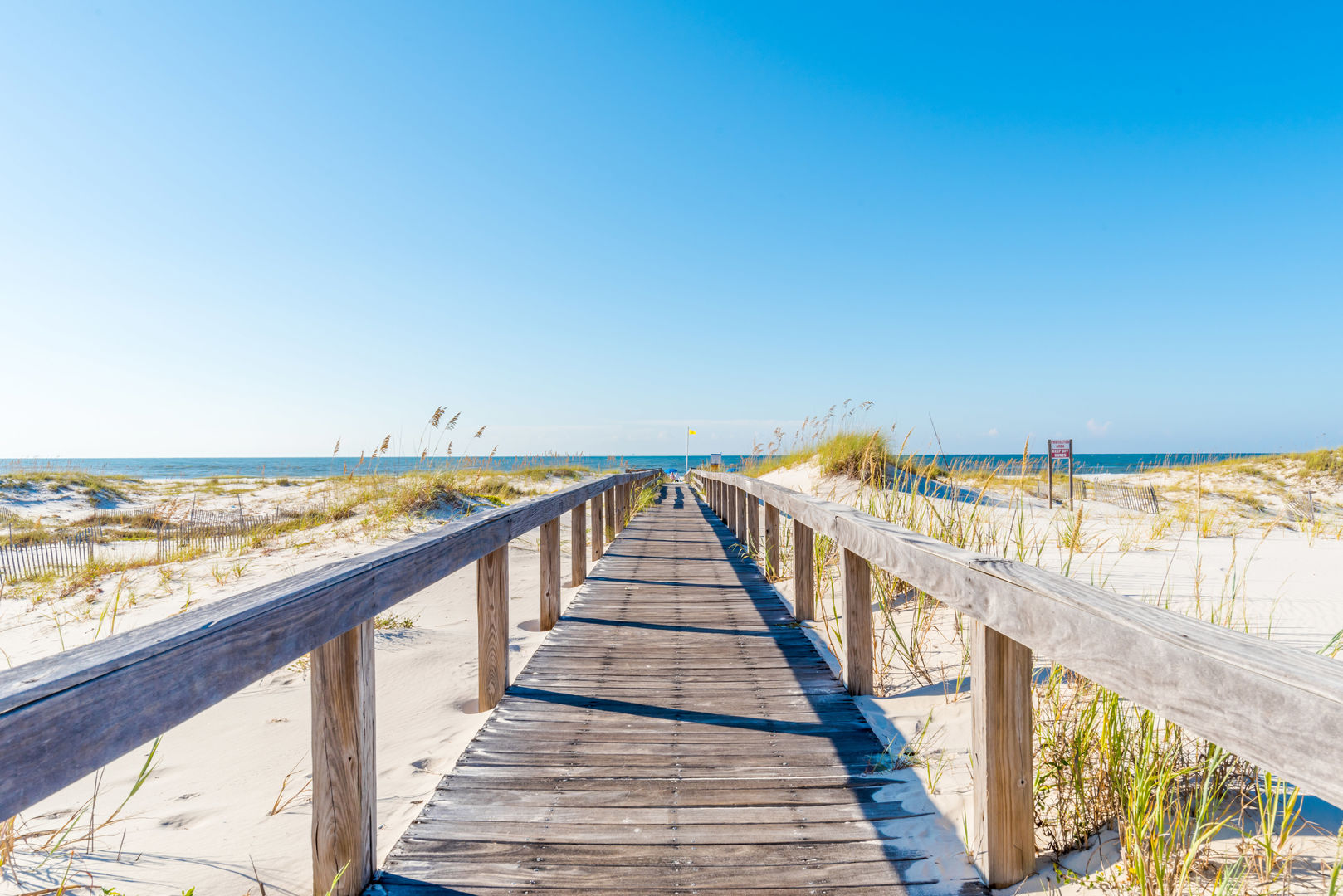 Come Escape To The Beautiful White Shores; picture of wood path leading to beach!