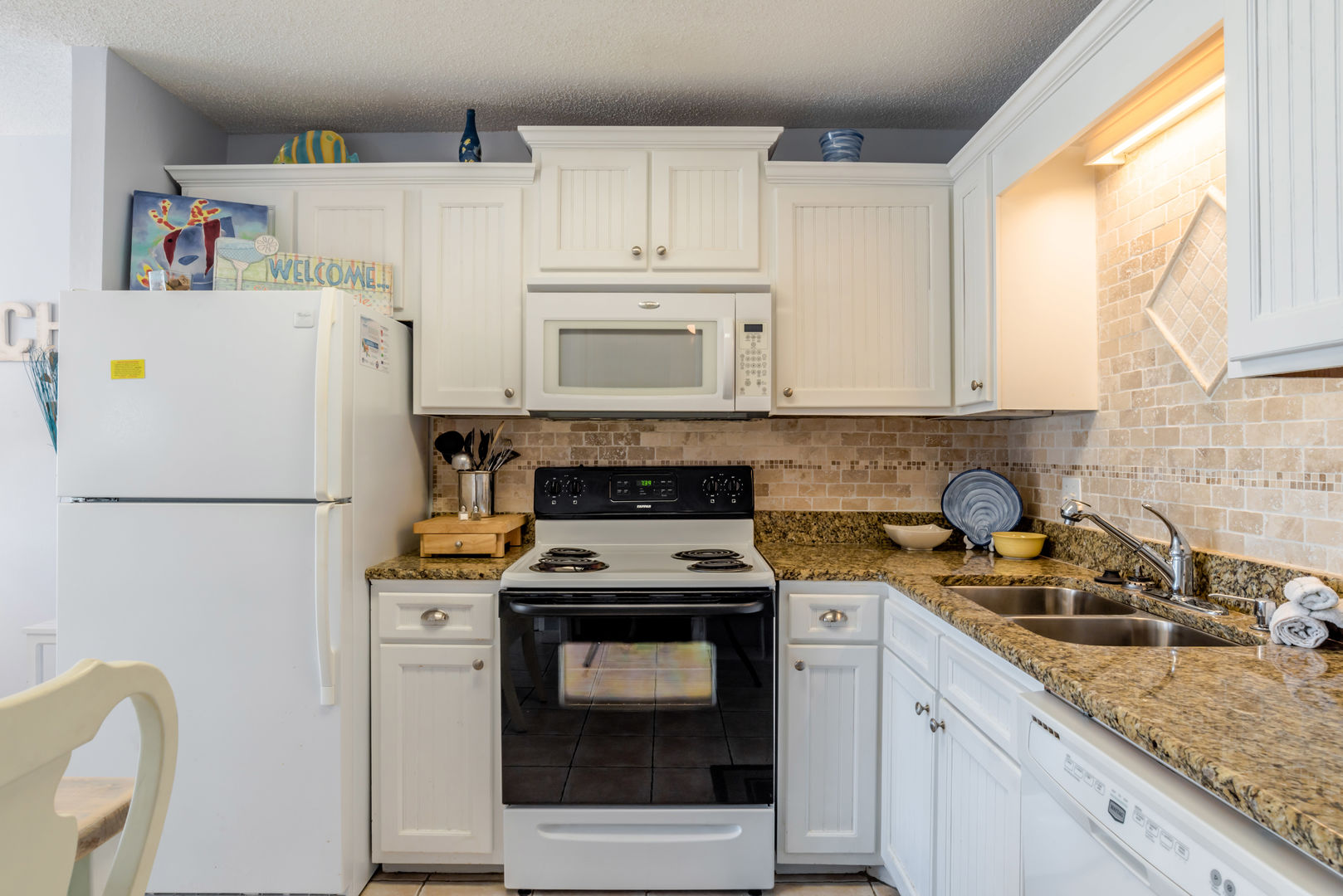 Fully Equipped Kitchen of this Fort Morgan Beach Rental, with modern appliances.