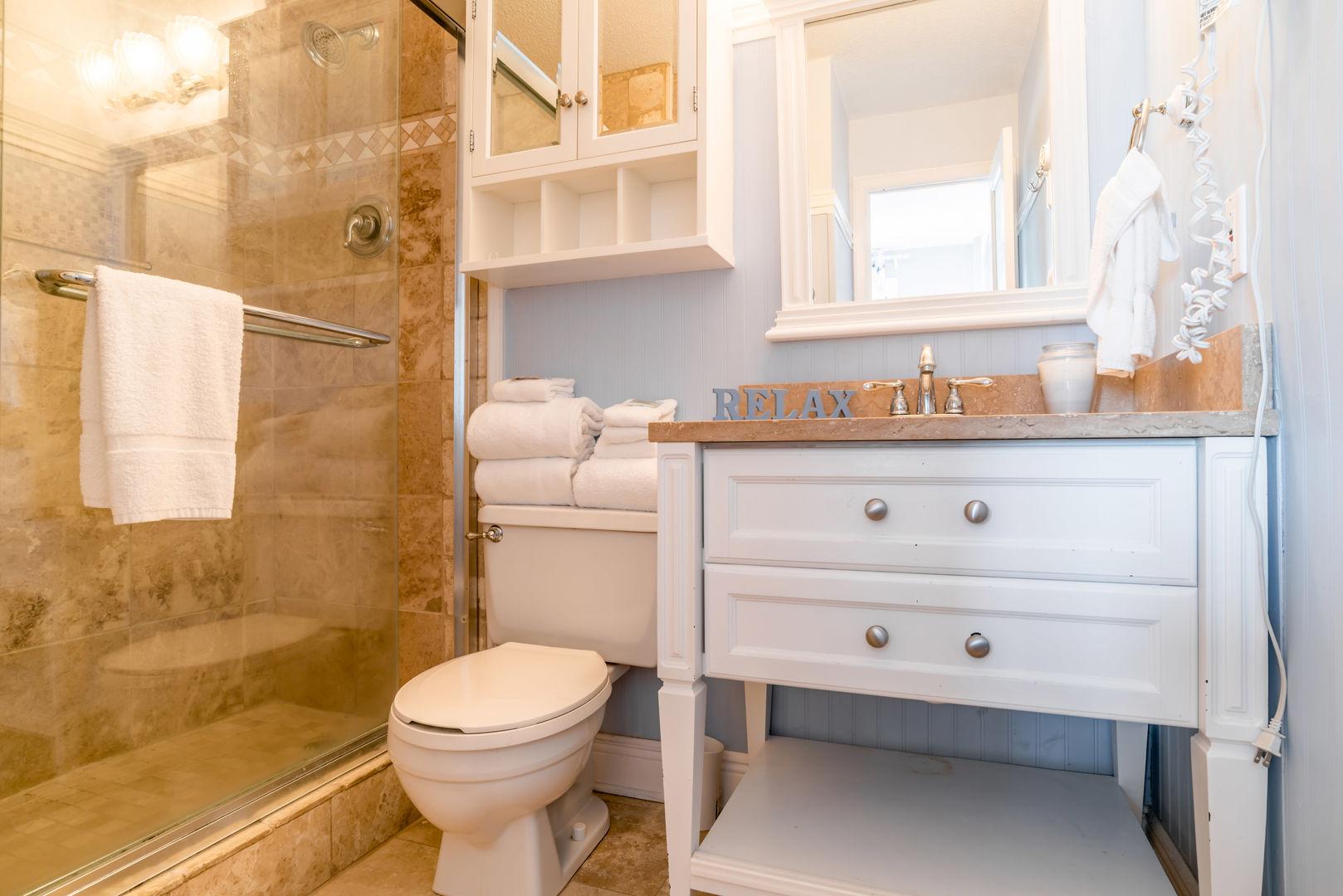 Master Bathroom Has A Walk-In Shower, toilet, and vanity sink.