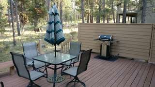 Deck with comfortable patio furniture and propane BBQ