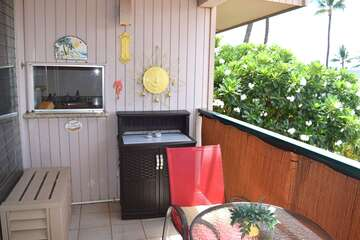 Beach themed lanai with window to the kitchen