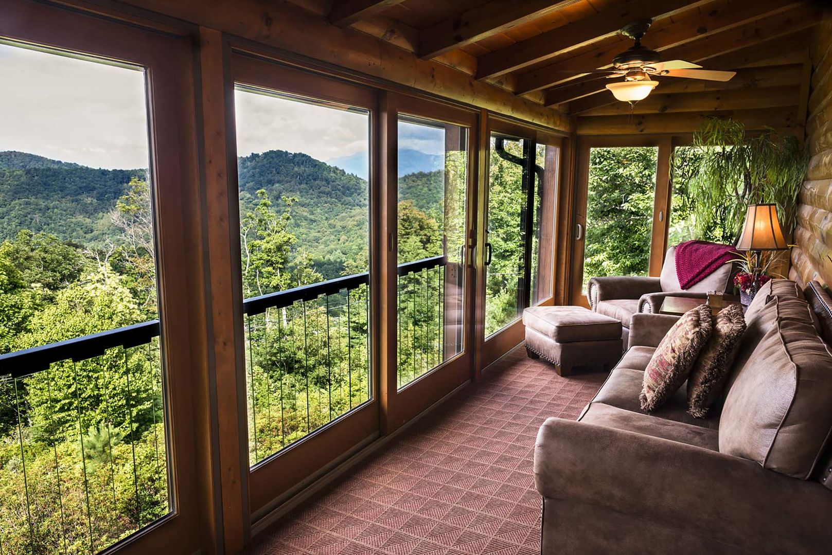 Covered, screened in porch with furnishings