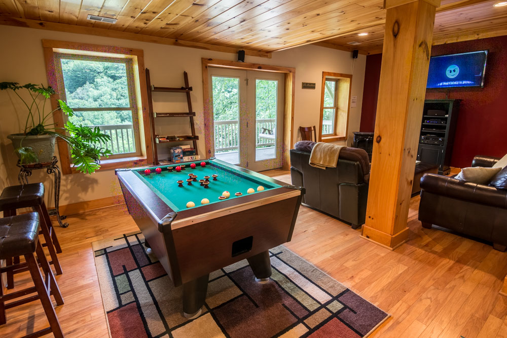 Lower level recreation room with pool table
