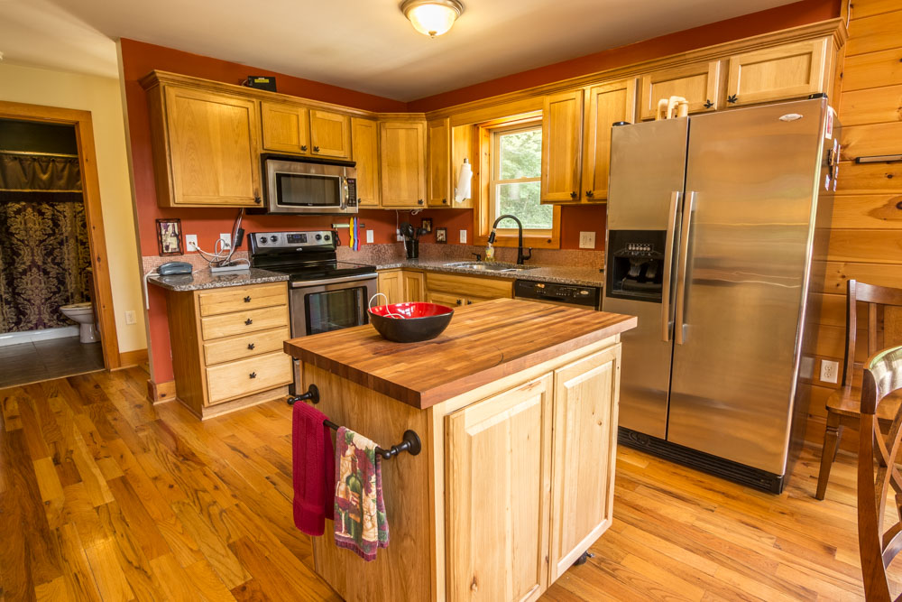 Chef's kitchen with granite counters, movable island and stainless steel appliances