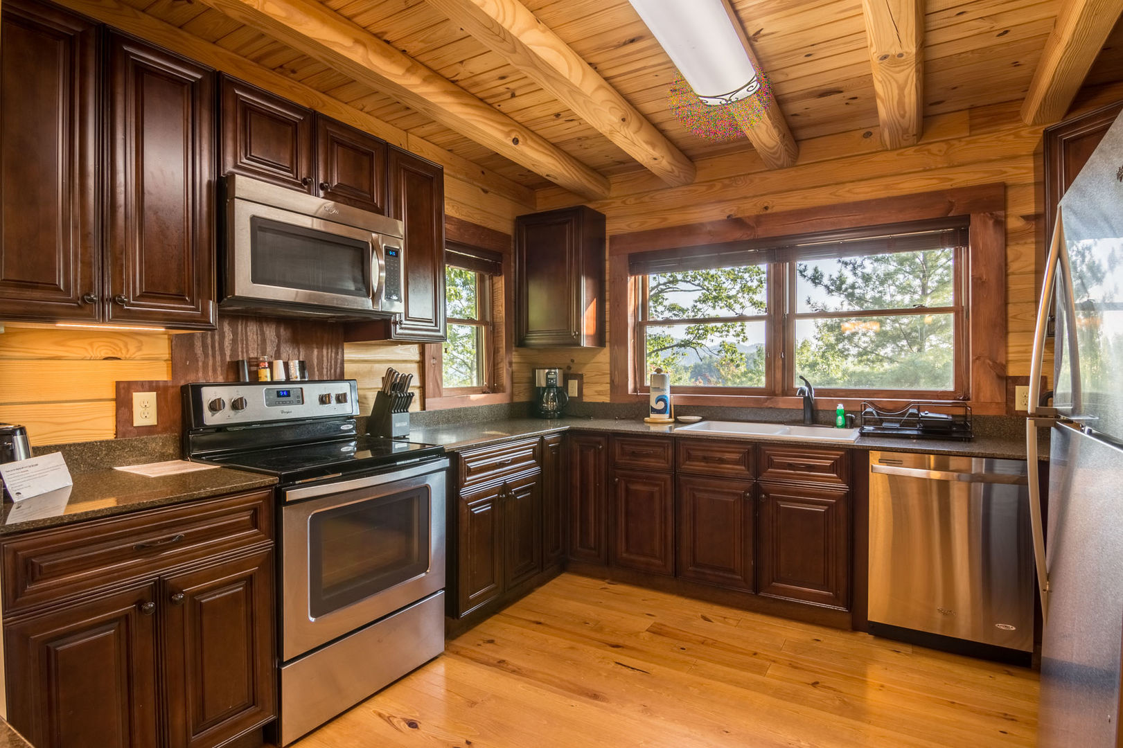 The kitchen has plenty of room and stainless steel appliances