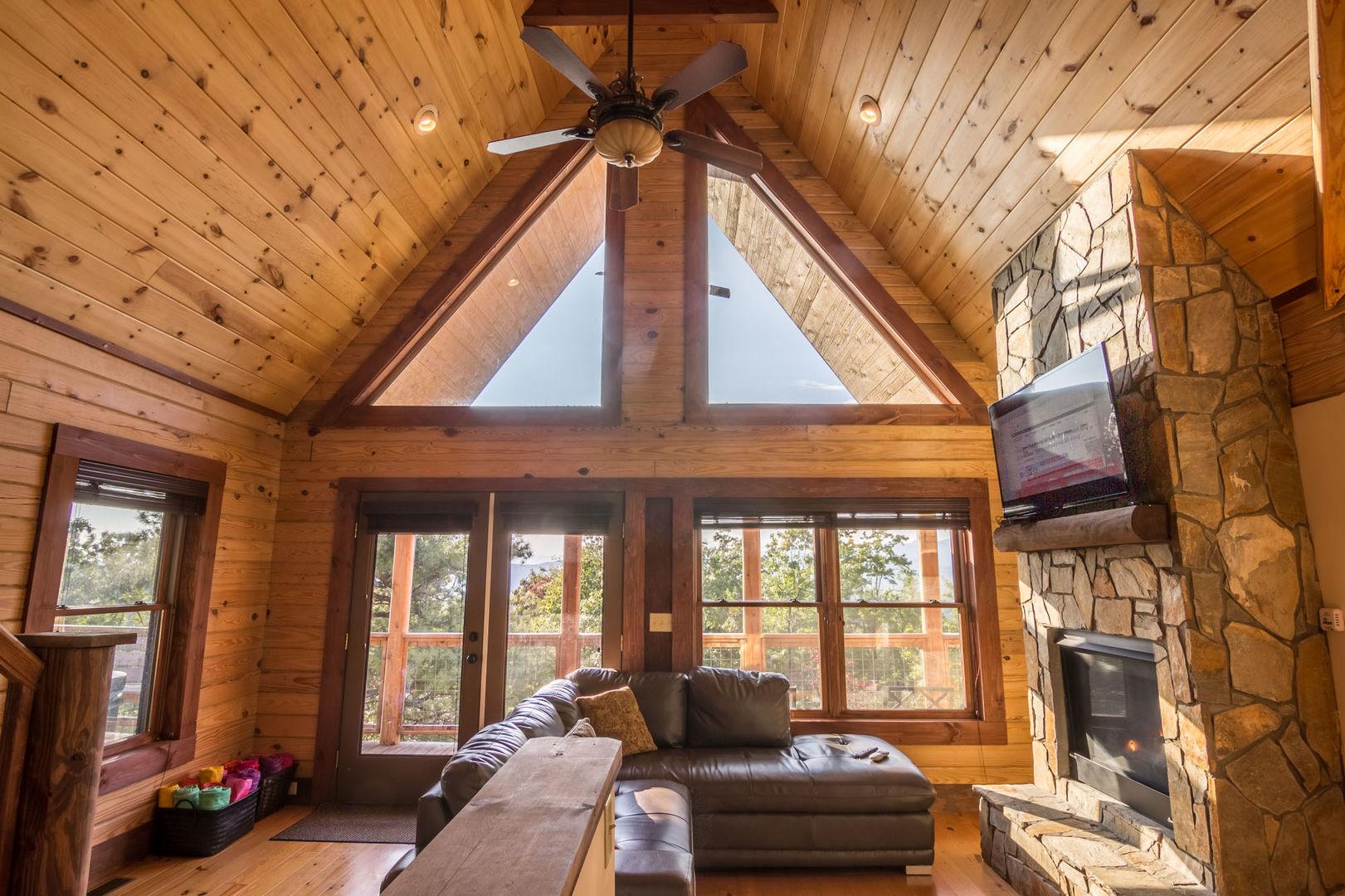 Living room with beautiful windows.