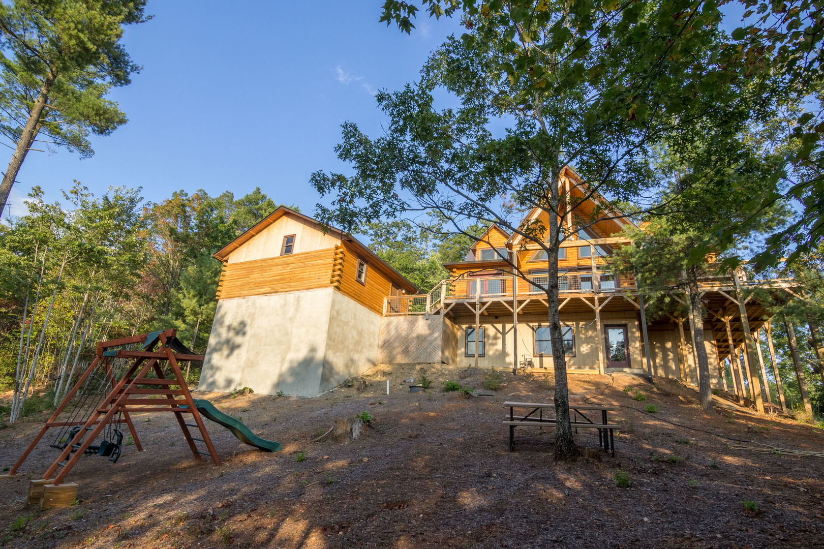 Experience this beautiful log home overlooking the mountains in a quiet gated community!