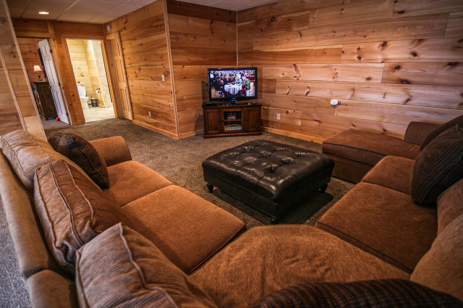 Second living area with sectional and TV