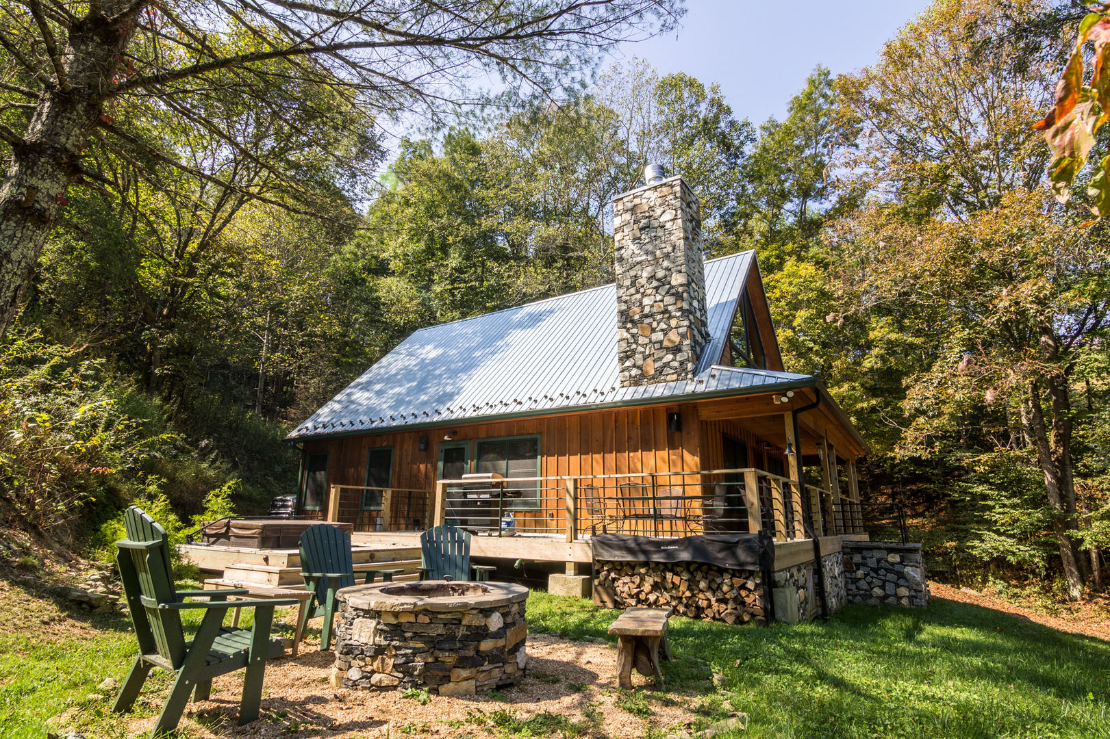 Side of the home with fire pit and chairs