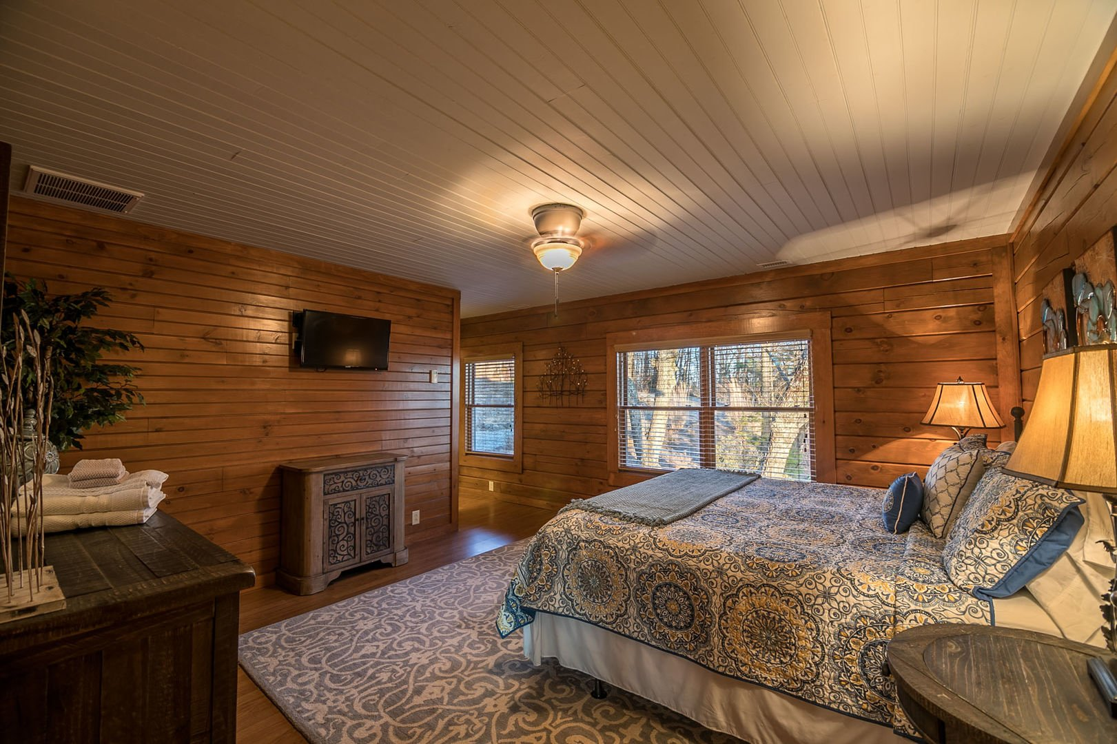 Main level bedroom with King sized bed and private bathroom