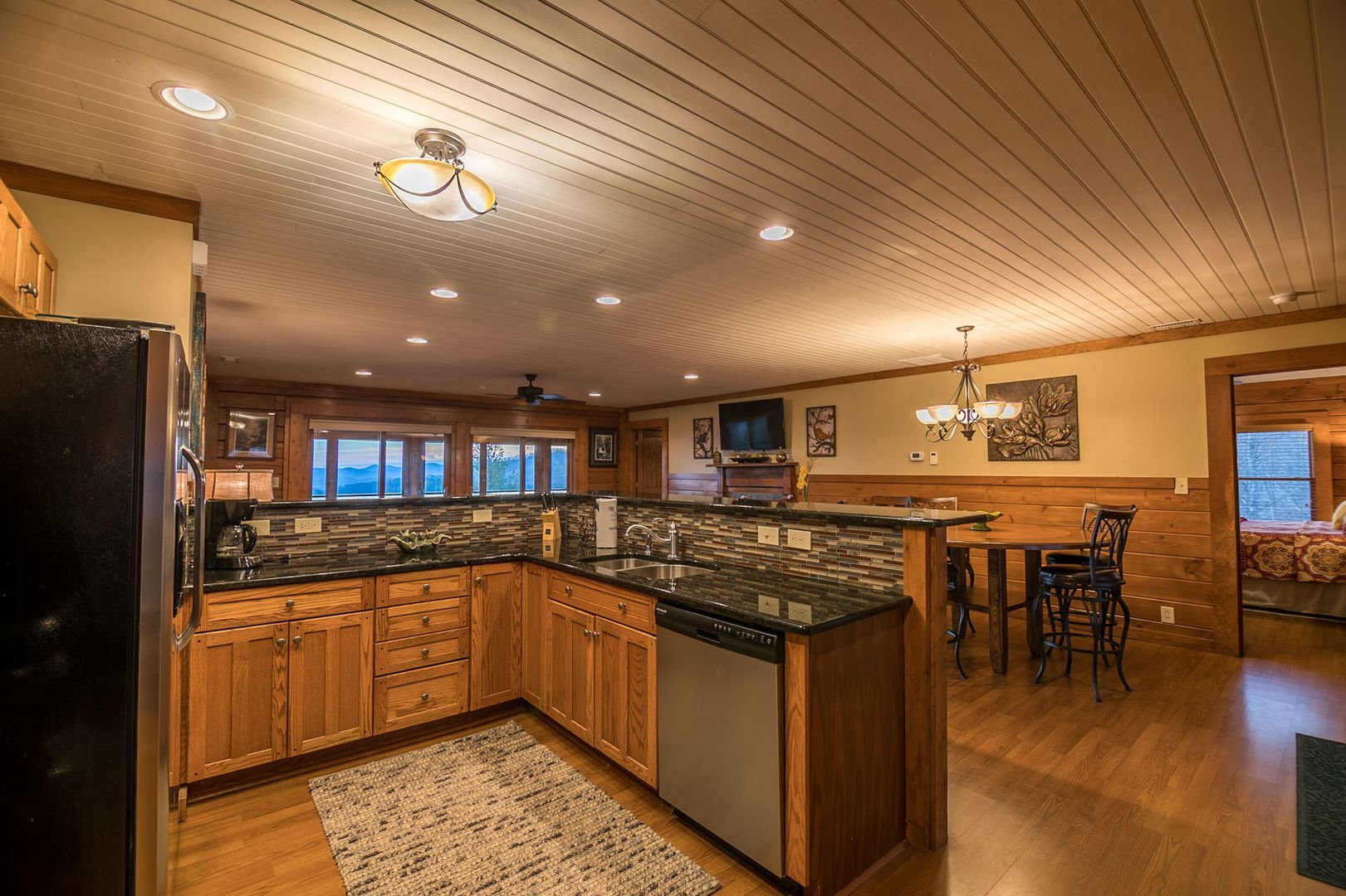 Kitchen with stainless steel appliances and granite counters
