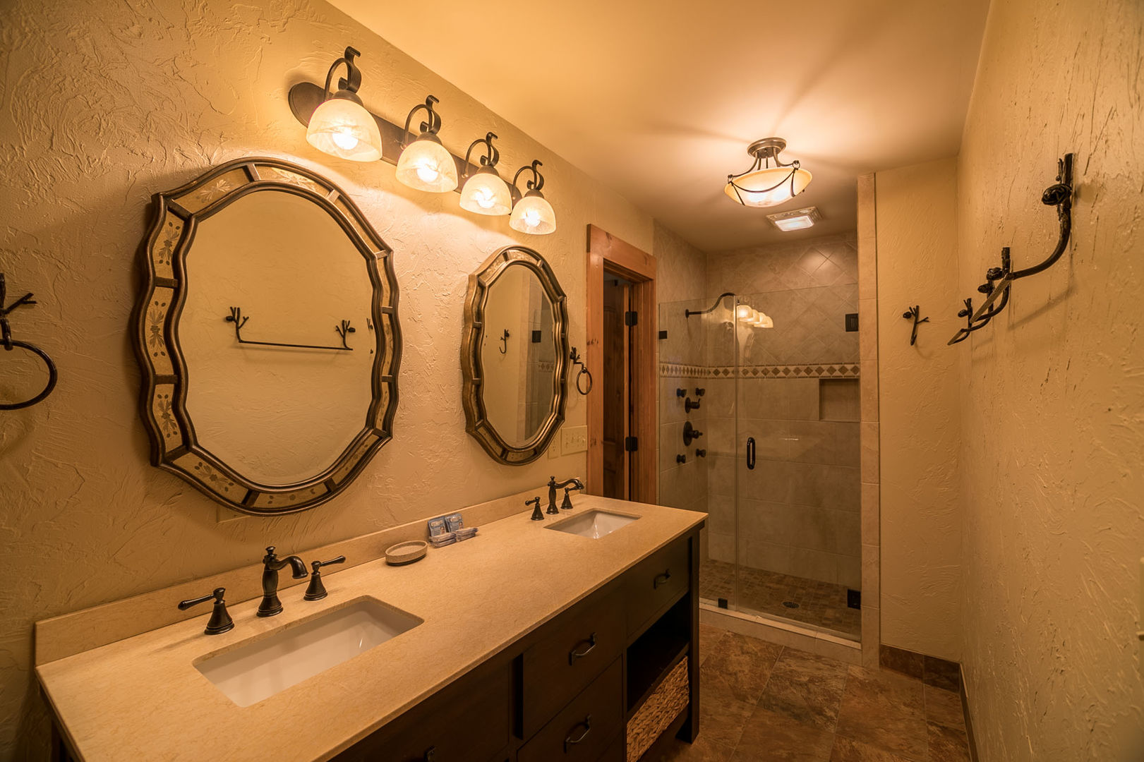 Bathroom with double vanities and shower