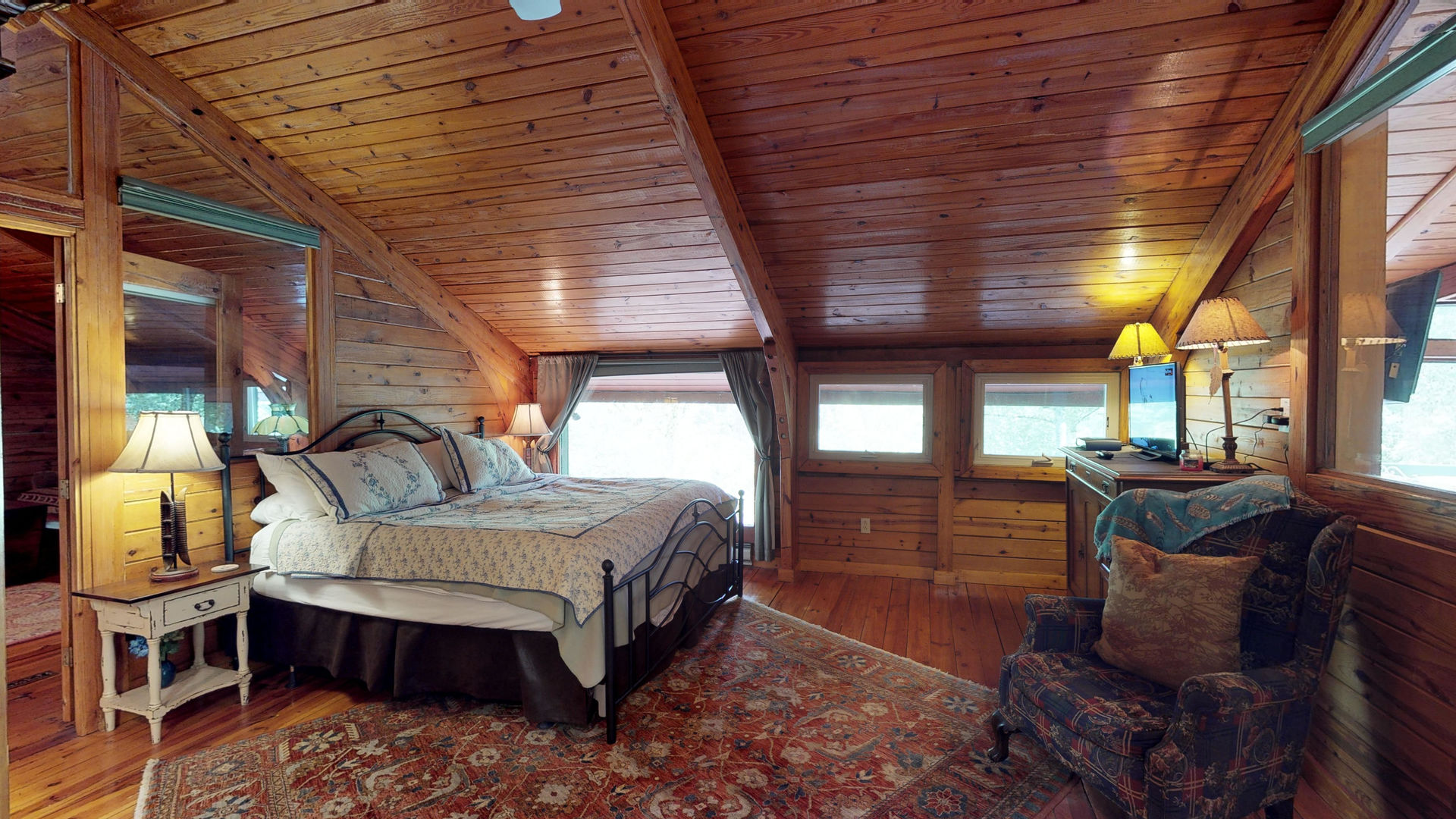 Upper level bedroom with king bed
