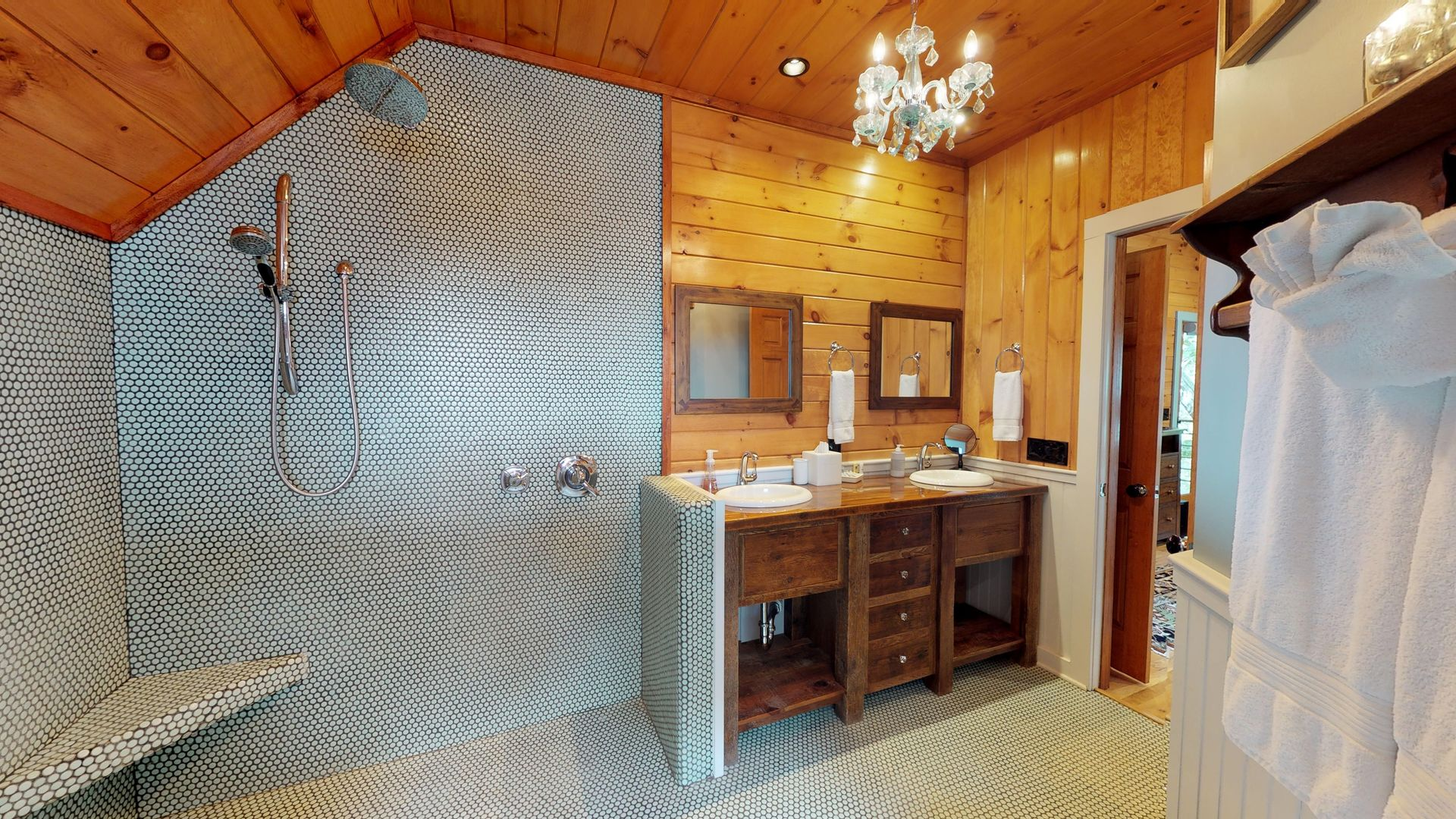 Open concept shower with toilet and bidet