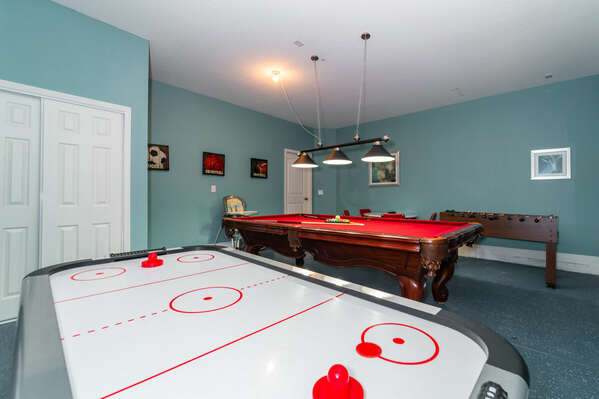 Garage converted to games room with foosball, pool table and air hockey. (downstairs)