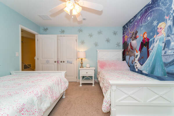 Beautiful Frozen themed bedroom (upstairs) has a double and a single bed.