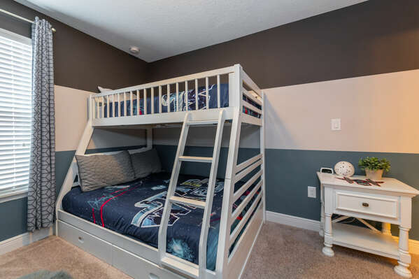 Bedroom 5 has single over double bunk beds and a Star Wars theme (upstairs)