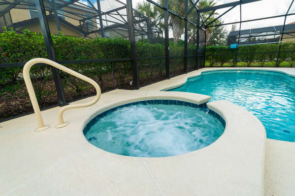 Hot tub and pool with showing privacy hedges