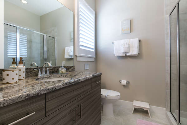 There is an ensuite bathroom with glass walk-in shower for the princess room
