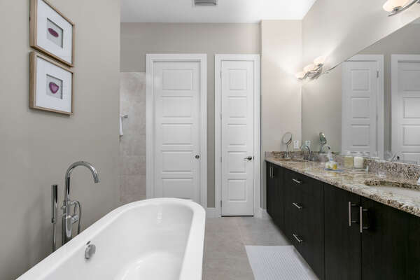 The ensuite bathroom is spacious and has a soaking tub and shower