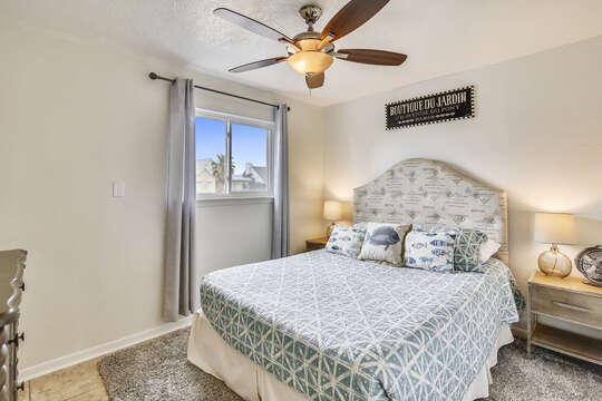 Reel Me In - guest bedroom on main level with a queen-size bed