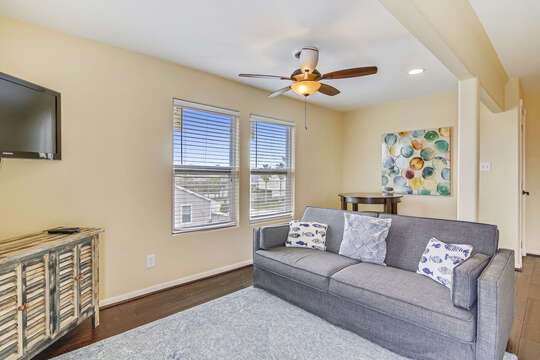 Reel Me In - upper-level second living area with flat-screen TV