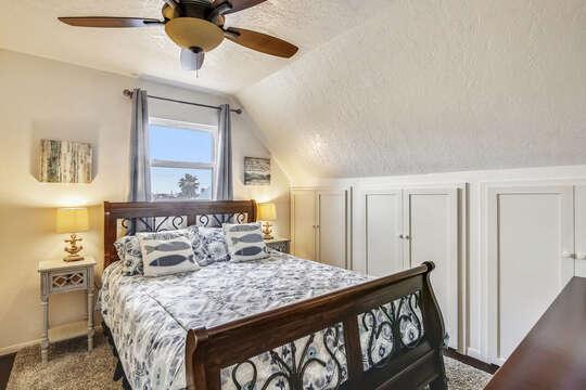 Reel Me In - upper-level guest bedroom with another queen bed