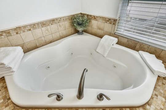 Reel Me In - master bedroom ensuite with large soaking tub
