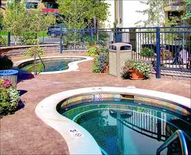 Two beautiful custom built Hot Tubs are right outside, shown in summer