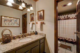 The private Bathroom within Bedroom 2 also has a large Granite vanity and separate full bath area