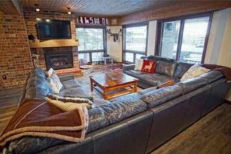 Large Living Room with Hardwood Floors, Sleeper Sofa, Gas Fireplace, HDTV