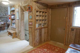 Entry also has storage cubbies and chairs