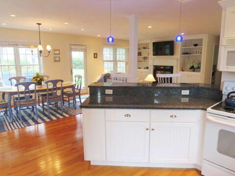 View from the kitchen to the open dining/living area - 24 Sea Mist Lane Chatham Cape Cod New England Vacation Rentals