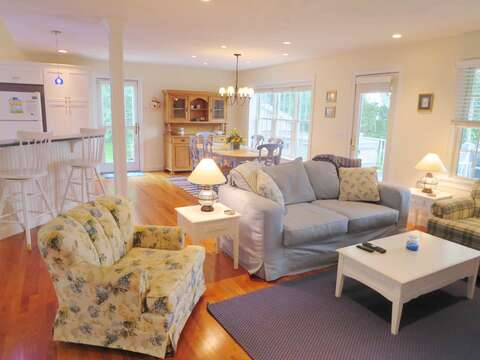 Light, bright, and open coastal living at its best. French door leads to the large deck - 24 Sea Mist Lane Chatham Cape Cod New England Vacation Rentals