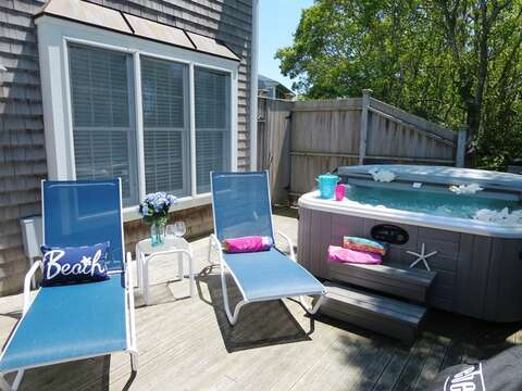 Enclosed outdoor shower, lounge chairs, outdoor dining, gas grill, and a hot tub! - 24 Sea Mist Lane Chatham Cape Cod New England Vacation Rentals