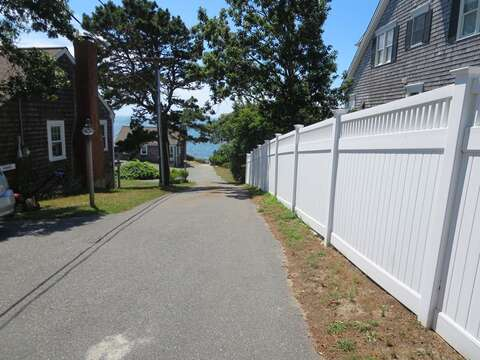 Just follow along the fence to the stairway to the beach - Sea Mist Lane Chatham Cape Cod New England Vacation Rentals