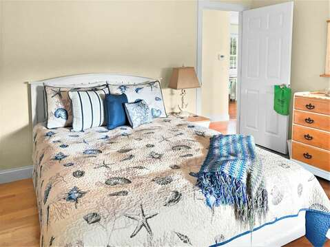 1st floor bedroom with a queen bed and dresser - 24 Sea Mist Lane Chatham Cape Cod New England Vacation Rentals